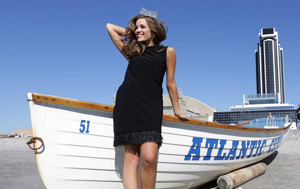 Miss America 2016 Betty Cantrell poses for photographers on the Atlantic City beach following the annual ocean toe dip in Atlantic City, N.J., the day after winning the crown.