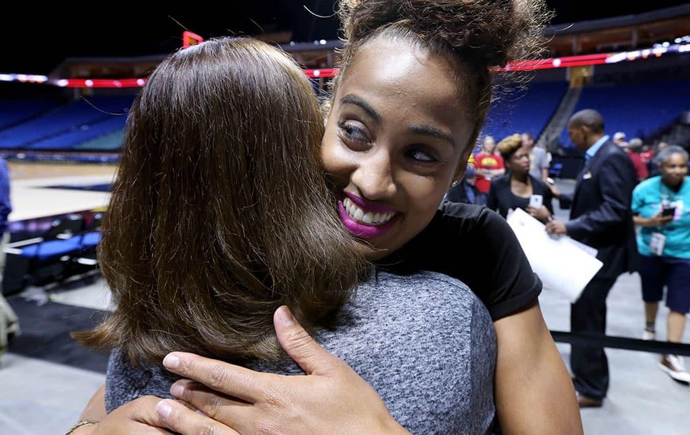 Tulsa Shock's Skylar Diggins, right, hugs season-ticket holder Lisa Clark following a WNBA basketball game against the Phoenix Mercury in Tulsa, Okla.