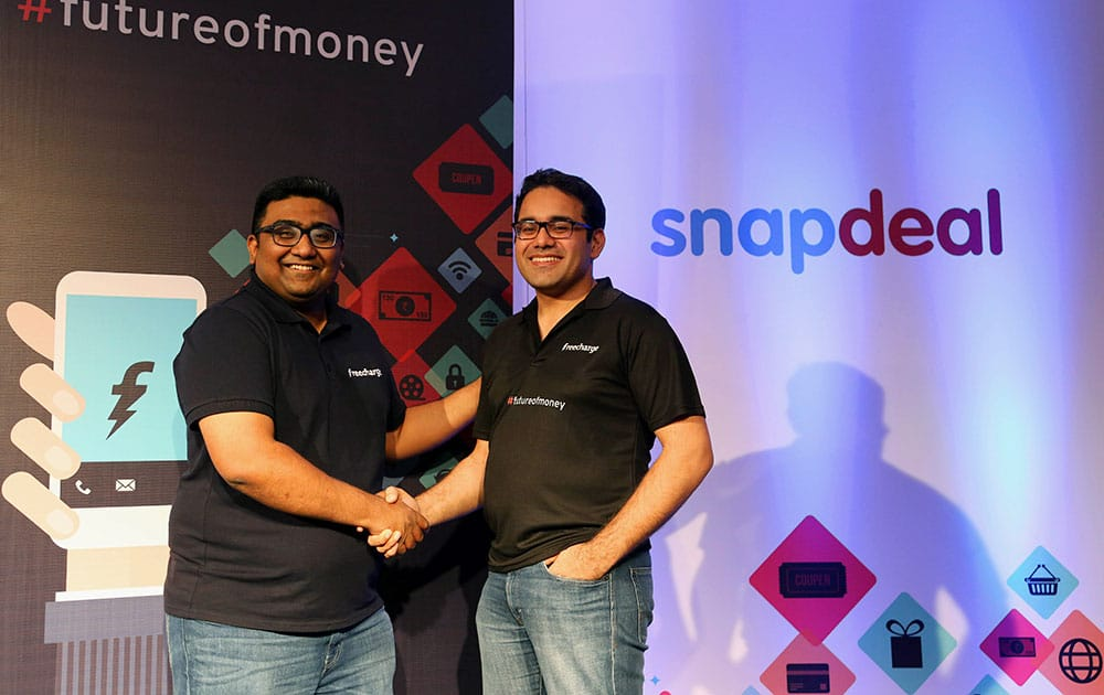 """Kunal Bahl, right, co-founder and Chief Executive Officer (CEO) of Snapdeal shakes hands with Kunal Shah co-founder and CEO of FreeCharge after the launch of """"Digital Wallet"""" in Bangalore."""