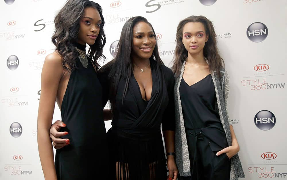 Serena Williams, center, poses with models backstage after she presented the Serena Williams Spring 2016 collection during Fashion Week in New York.