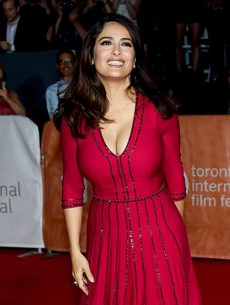 Actress Salma Hayek poses for photographs on the red carpet for the new movie