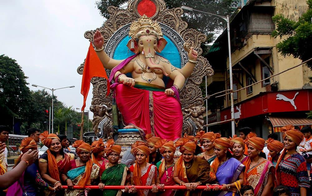 Devotees transport an idol of Hindu god Ganesha from a workshop to a worship venue ahead of the Ganesh Chaturthi festival in Mumbai.
