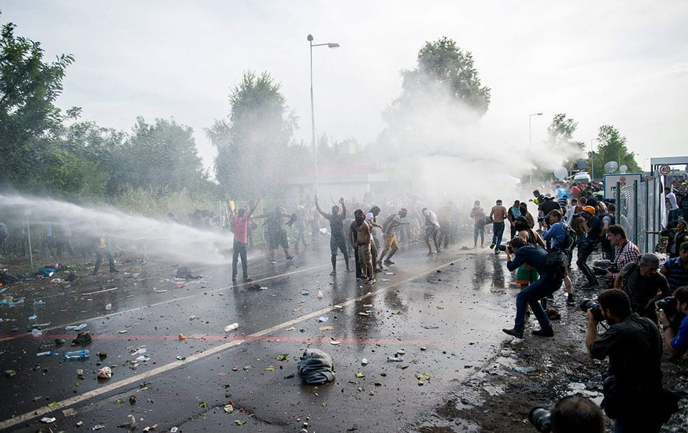 Hungarian police use water canons against migrants at the Horgos 2 border crossing into Hungary, near Horgos, Serbia.