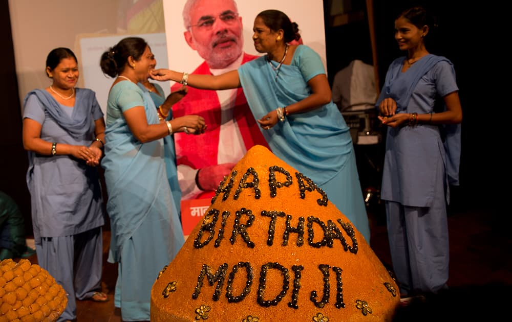Members of India's non-governmental organization Sulabh International celebrate Prime Minister Narendra Modi's birthday in New Delhi.