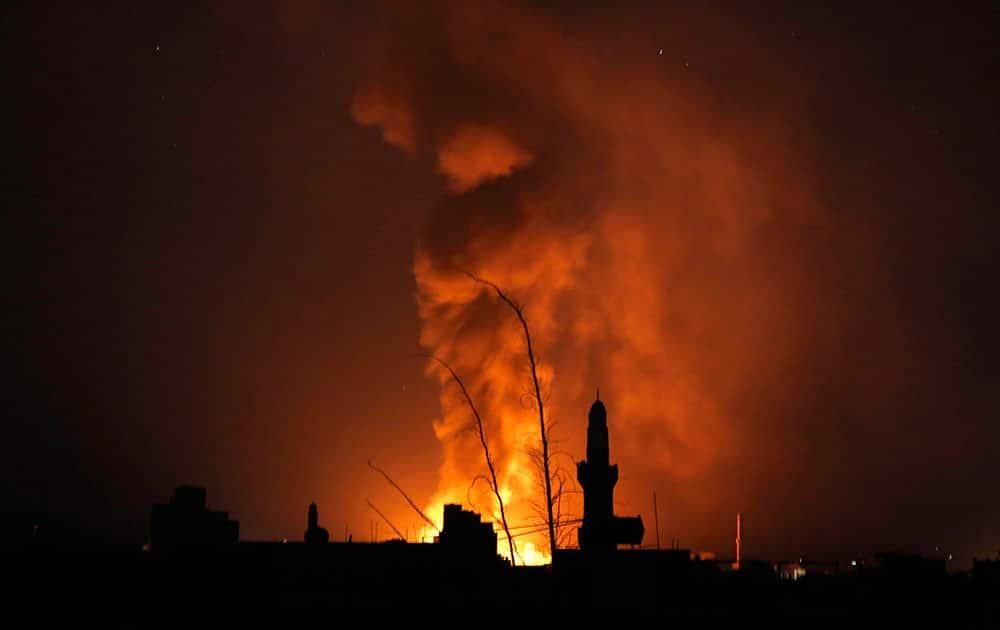 Fire and smoke rise after a Saudi-led airstrike in Sanaa, Yemen.