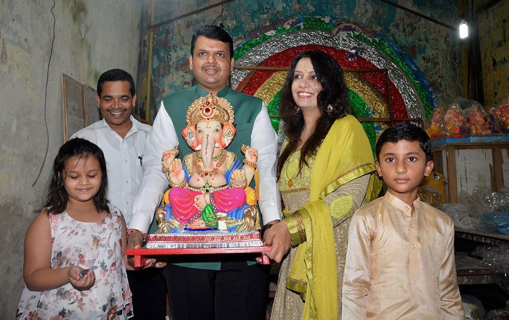 Maharashtra CM Devendra Fadnavis with his family during the Ganpati festival in Mumbai.