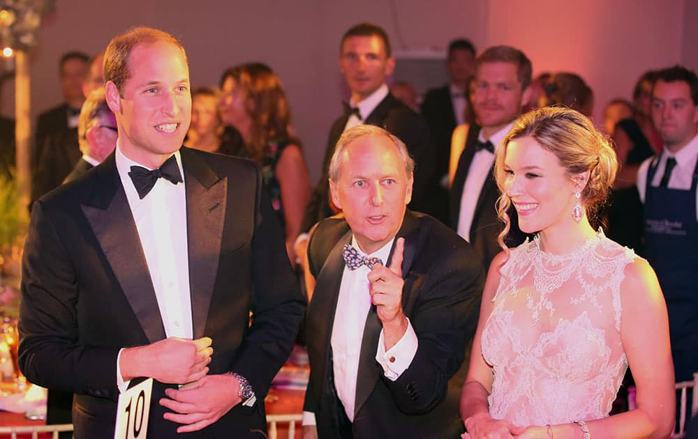 Britain's Prince William, the Duke of Cambridge, left, CEO of Tusk Trust Charlie Mayhew and British singer Joss Stone smile, during the Tusk Trust conservation charity 25th Anniversary Ball, at Syon House, in London.