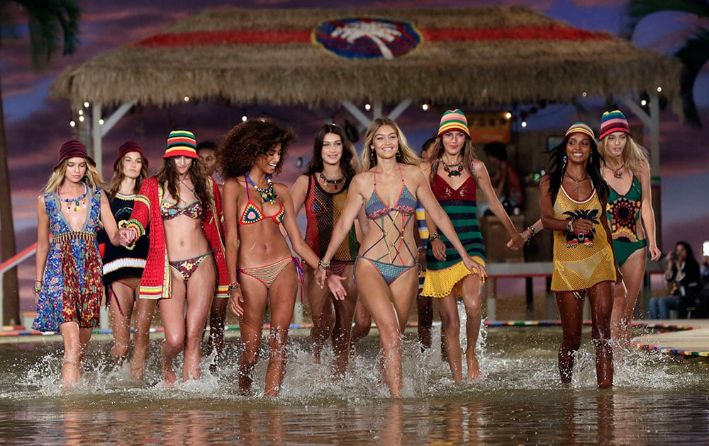 models wade through the water during the finale of the Tommy Hilfiger Spring 2016 collection during Fashion Week in New York.