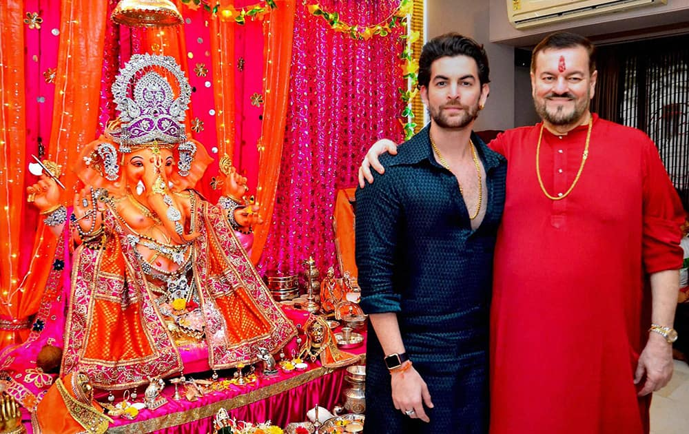 Neil Nitin Mukesh with his father singer Nitin Mukesh (R) during the Ganesh festival celebrations at their residence in Mumbai.