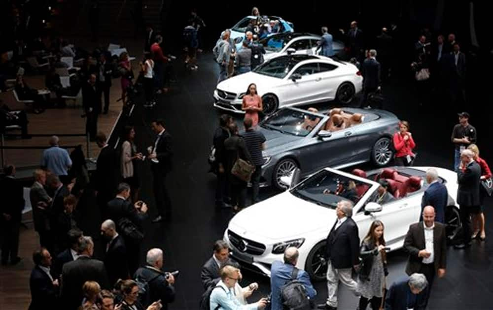 Visitors surround cars in the Mercedes hall on the first press day of the Frankfurt Auto Show IAA in Frankfurt, Germany.