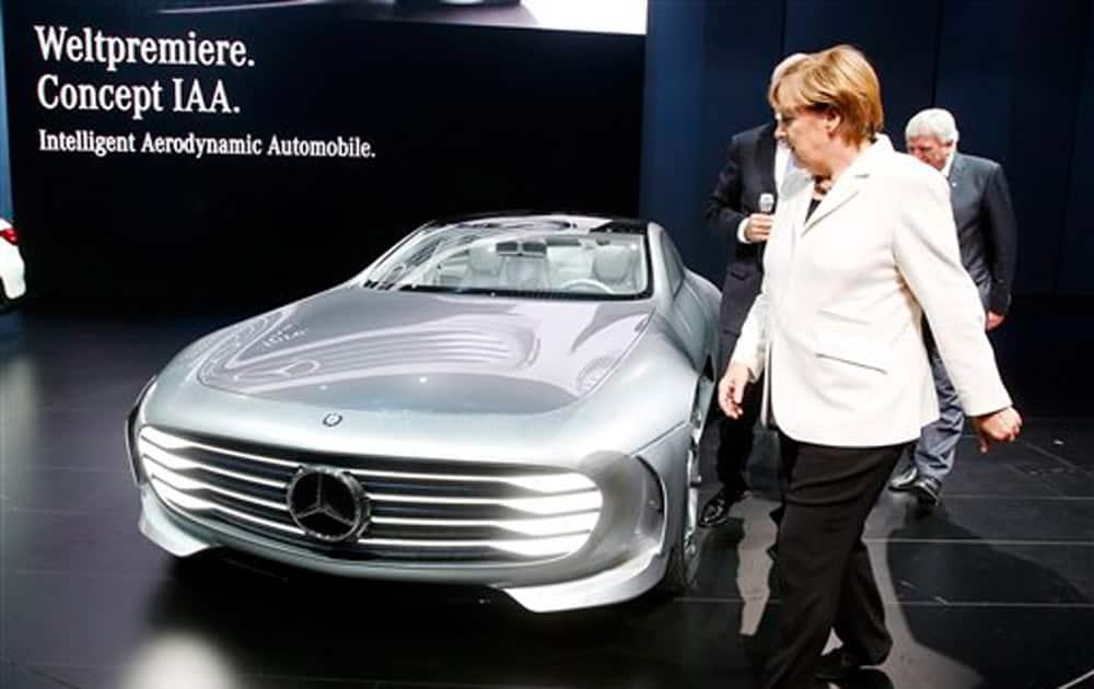 German Chancellor Angela Merkel stands next to a Mercedes Concept car IAA as she visits the Frankfurt Auto Show IAA in Frankfurt, Germany.