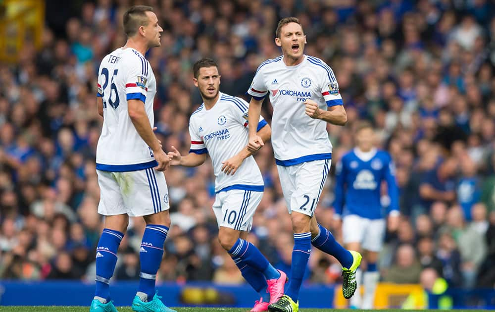 Chelsea's Nemanja Matic, centre right, celebrates after scoring during the English Premier League soccer match between Everton and Chelsea at Goodison Park Stadium, Liverpool, England.