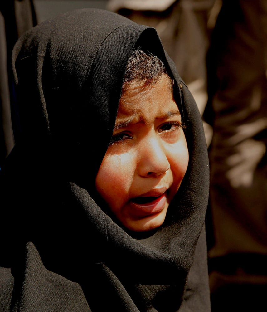 A Kashmiri girl cries during a protest against the killing of a 3-year-old boy, in Srinagar, India.