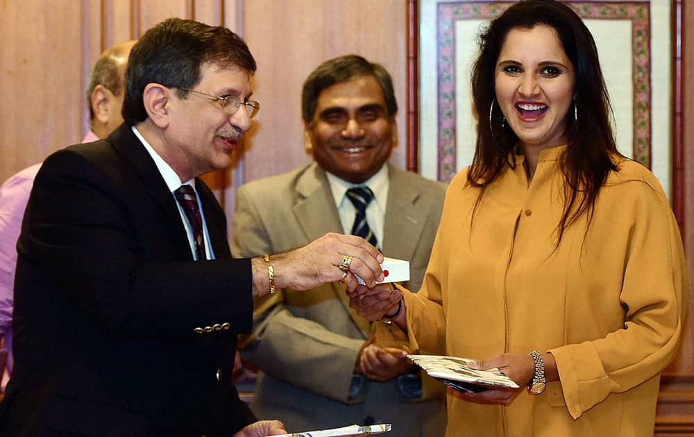 Tennis player Sania Mirza during an event where she was confered with a honorary membership of Cricket Club of India by K Nicholson, President of CCI in Mumbai.