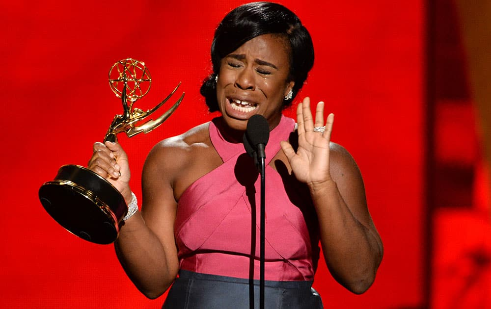 """Uzo Aduba accepts the award for outstanding supporting actress in a drama series for """"Orange Is The New Black"""" at the 67th Primetime Emmy Awards."""