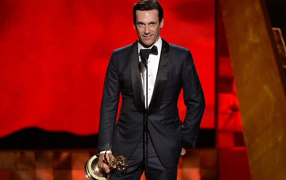 "Jon Hamm accepts the award for outstanding lead actor in a drama series for ""Mad Men"" at the 67th Primetime Emmy Awards."