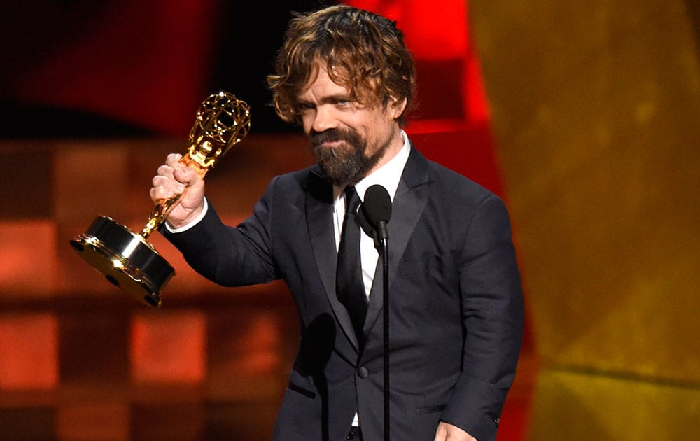 "Peter Dinklage accepts the award for outstanding supporting actor in a drama series for ""Game of Thrones"" at the 67th Primetime Emmy Awards."
