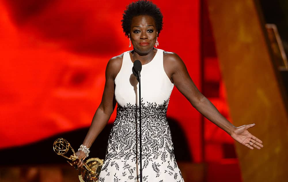 "Viola Davis accepts the award for outstanding lead actress in a drama series for ""How to Get Away With Murder"" at the 67th Primetime Emmy Awards."