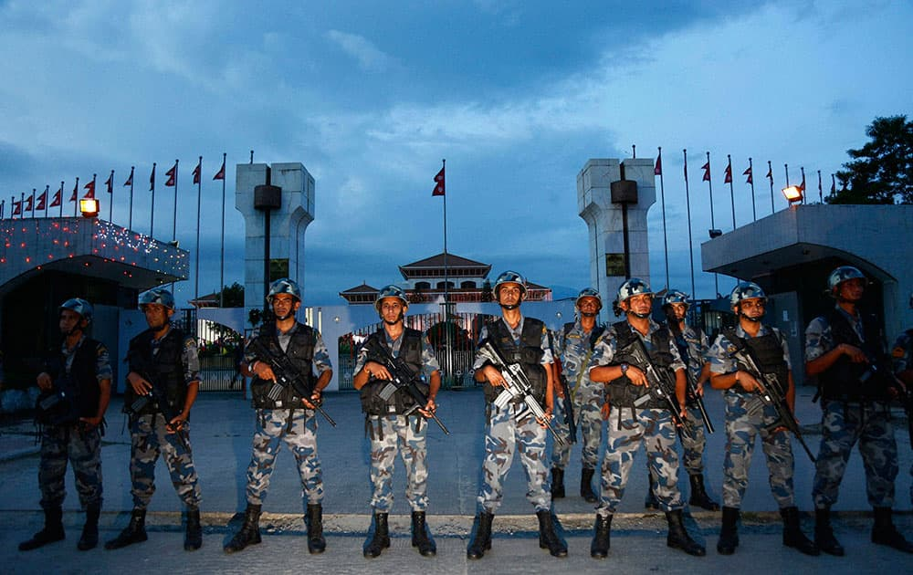 Nepalese policemen stand guard in front of the constituent assembly hall where a ceremony to adopt the countrys new constitution in in progress in Kathmandu, Nepal. Nepalese President Ram Baran Yadav signed the constitution and made the proclamation announcement, setting off a roar of applause from members of the Constituent Assembly in Kathmandu.