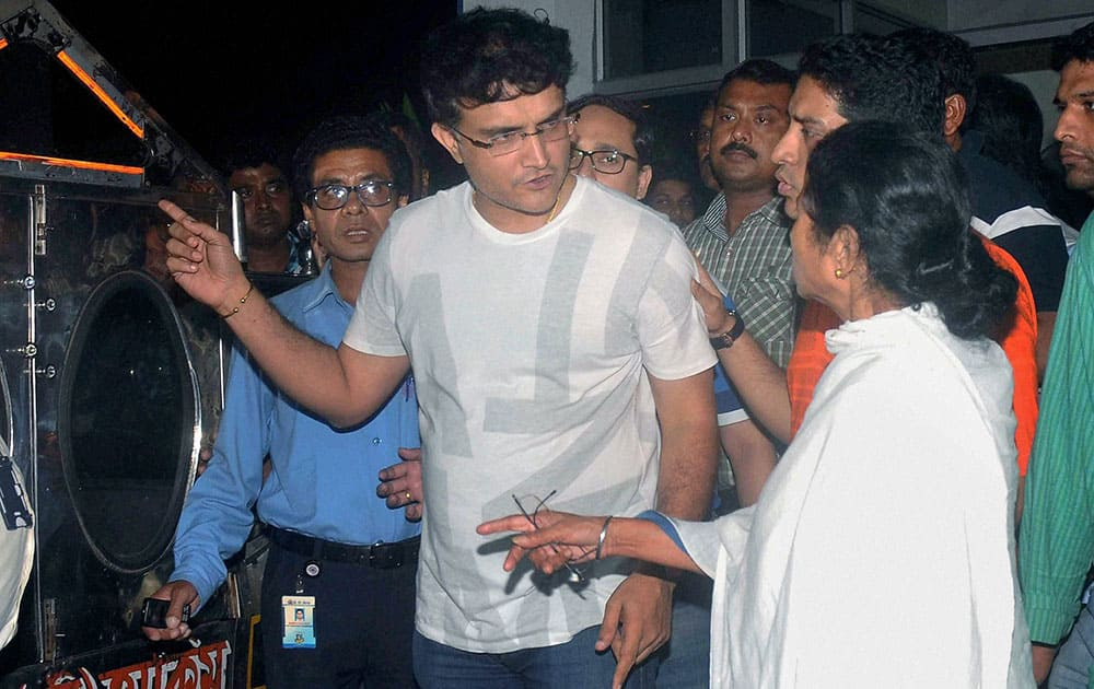 West Bengal Chief Minister Mamata Banerjee with former Indian cricket captain Sourav Ganguly at a private hospital where BCCI President Jagmohan Dalmiya passed away, in Kolkata.