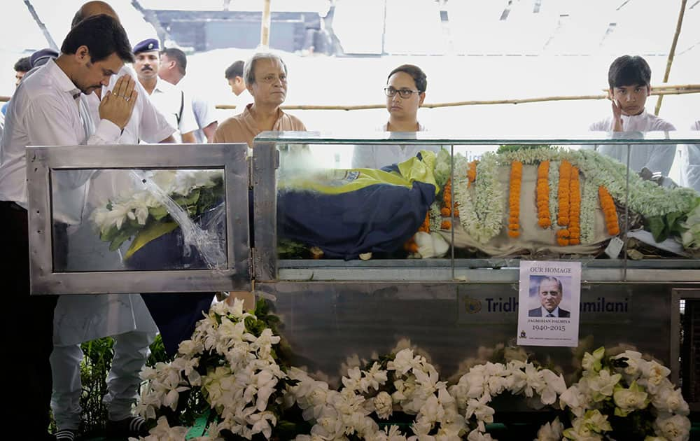 The Board of Control for Cricket in India (BCCI) Secretary Anurag Thakur pays tribute to the body of Jagmohan Dalmiya, in glass casket, BCCI president and former International Cricket Council chief during his funeral in Kolkata.