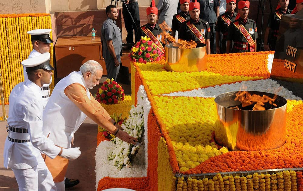Prime Minister Narendra Modi lays a wreath at Amar Jawan Jyoti, India Gate, during a ceremony to pay homage to soldiers who sacrificed their lives in 1965 war, in New Delhi.