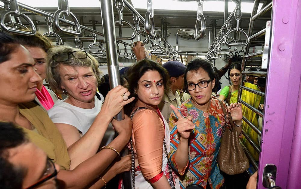 Managing Director and Chief Operating Officer of World Bank, Mulyani Indrawati (wearing spectacles) commutes in a second class ladies compartment of a Western Railway suburban local in Mumbai.