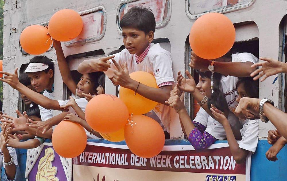Deaf children enjoy a tram ride during International Deaf Week celebration in Kolkata.