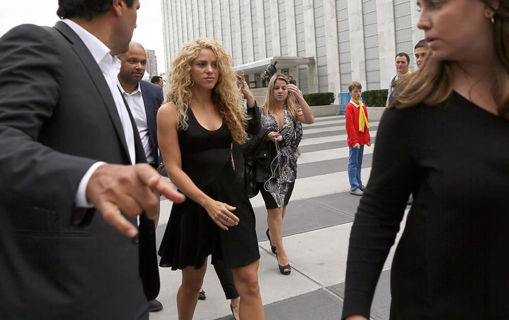 UNICEF and United Nations Goodwill Ambassador Shakira, center, is escorted by her security as she leaves the U.N. headquarters.