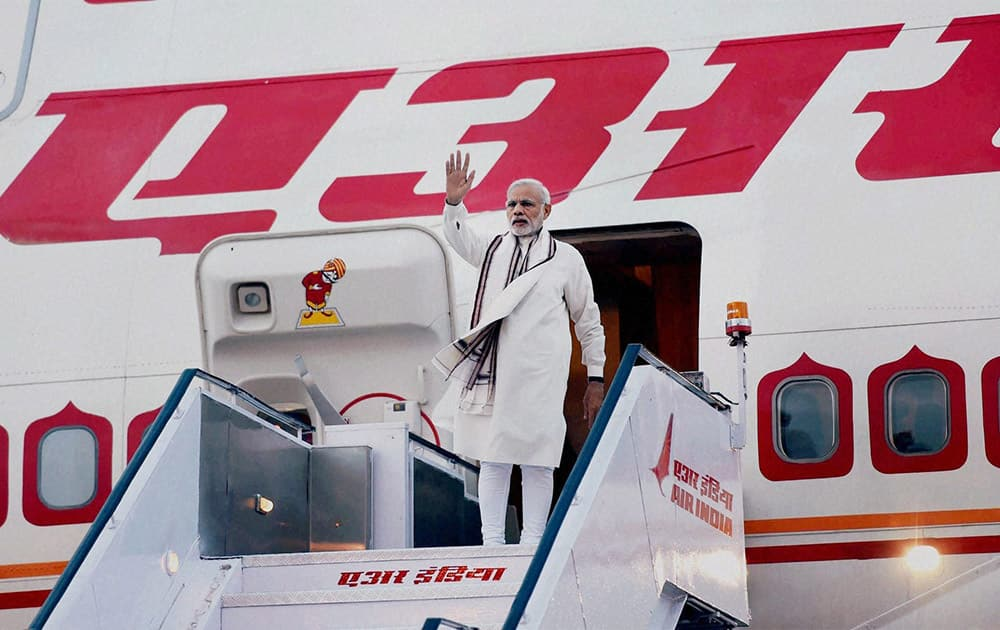 Prime Minister Narendra Modi waves as he departs for his two- nation tour of Ireland and the USA, in New Delhi.
