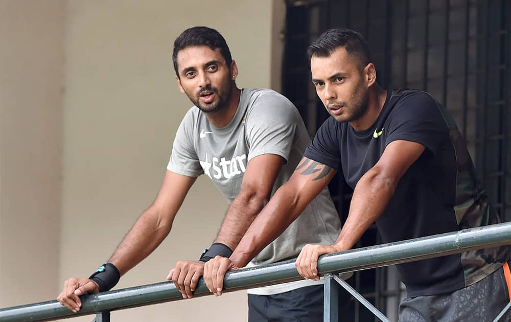 Cricketers Stuart Binny and S Arvind during the preparatory camp for the upcoming series against South Africa at NCA in Bengaluru.