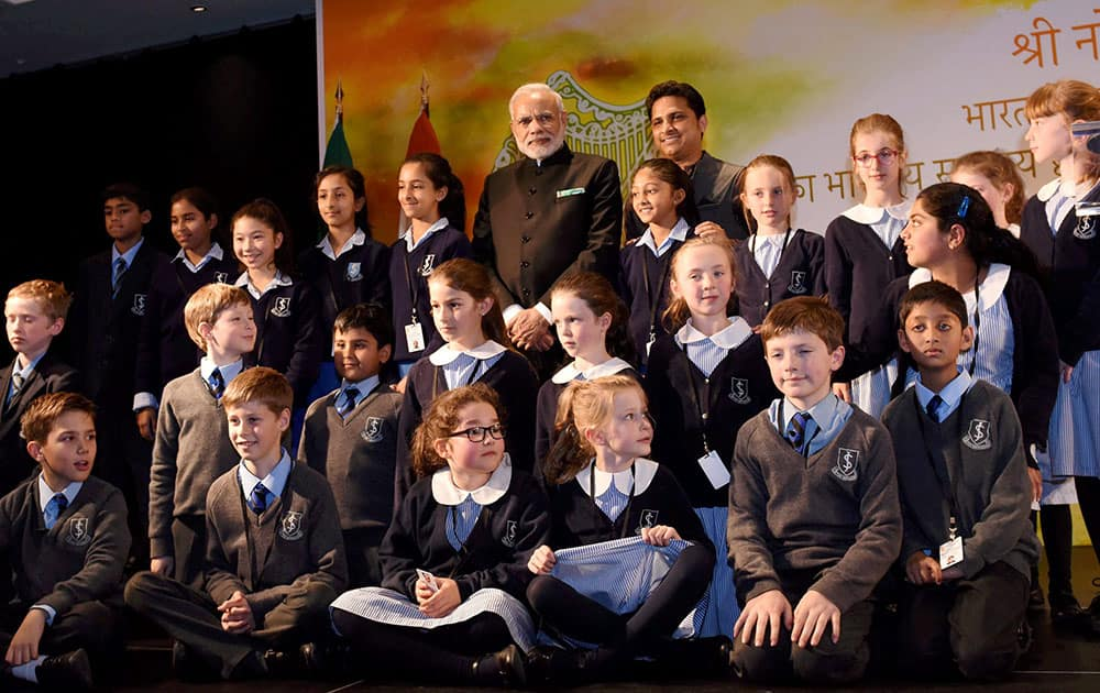 Prime Minister Narendra Modi at a group photo with the children who performed during an interaction with the Indian community people in Dublin.