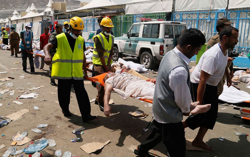 Emergency services attend to victims of a crush in Mina, Saudi Arabia during the annual hajj pilgrimage. Hundreds were killed and injured, Saudi authorities said.