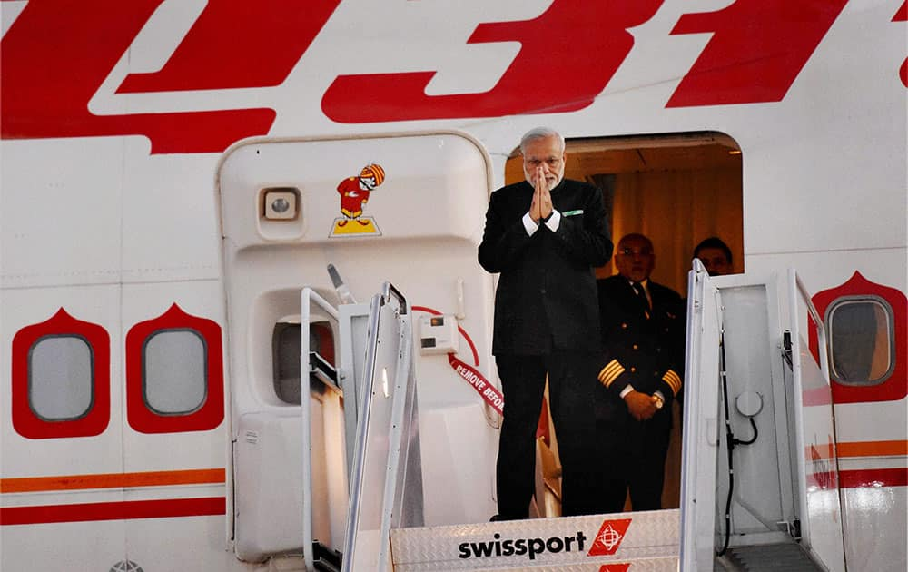 Prime Minister Narendra Modi gestures upon his arrival at John F Kennedy International Airport in New York.