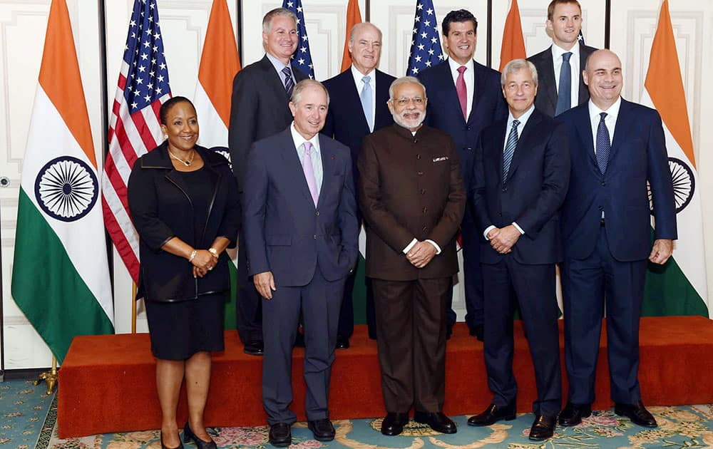 Prime Minister Narendra Modi poses before a meeting with officials of top Financial institutions in New York.