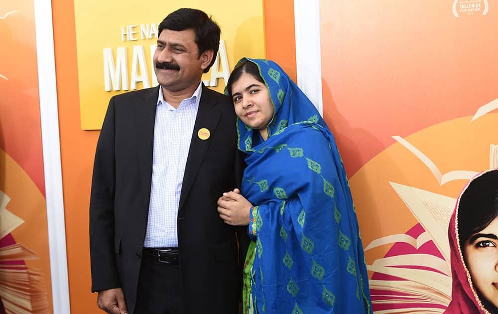 Ziauddin Yousafzai and Malala Yousafzai attend the premiere of