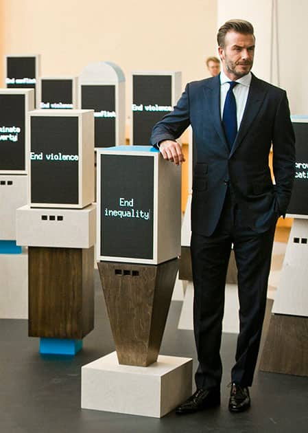 English soccer star David Beckham, a goodwill ambassador for UNICEF, poses next to a digital installation created for UNICEF by Google.