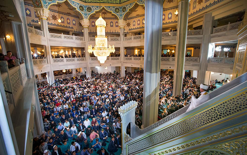 Russia's top Muslim Cleric Ravil Gainutdin, right, conducts a religious service inside the newly restored Moscow Cathedral Mosque during celebrations of Eid al-Adha, a feast celebrated by Muslims worldwide, which Muslims in Russia call Kurban-Bairam, in Moscow, Russia.