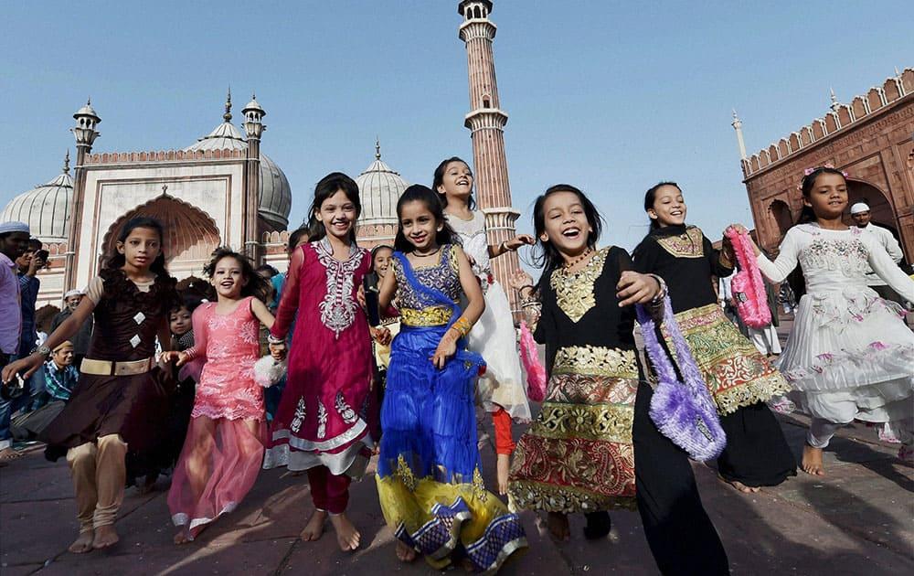 Muslim children jubilate at Jama Masjid on the occasion of Eid al-Adha at Jama Masjid in New Delhi.