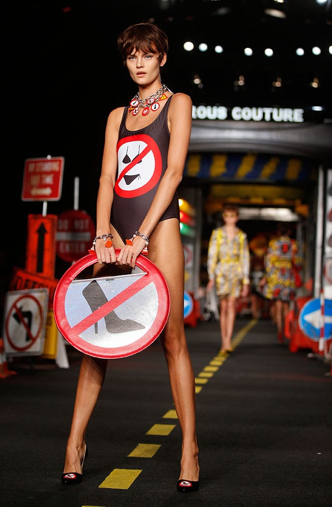A model wears a creation for Moschino women's spring-summer 2016 collection, part of the Milan Fashion Week, unveiled in Milan, Italy.