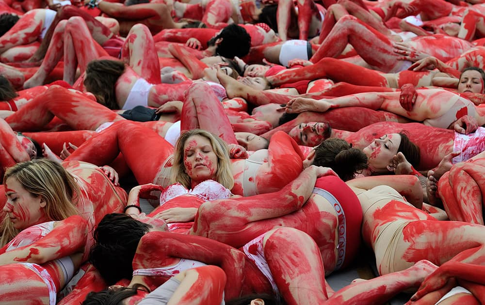 Animal rights activists lay on the ground covered in fake blood during a protest against animal suffering and meat consumption as part of the World Day for the Abolition of Meat in Paris, France.