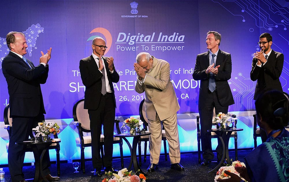 Prime Minister Narendra Modi with Microsoft CEO Satya Nadella (2nd L), John T. Chambers, Executive Chairman of Cisco, Paul E. Jacobs, Executive Chairman of Qualcomm and Google CEO Sundar Pichai (R) during the Digital India and Digital Technology dinner function in San Jose.