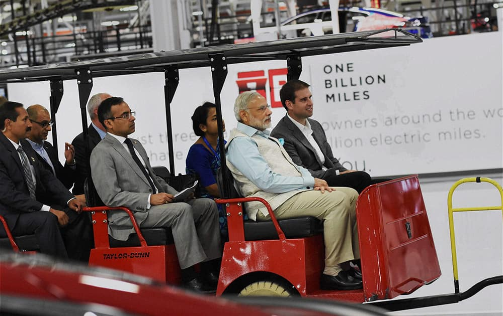 Prime Minister Narendra Modi takes ride in electric car during a visit of TESLA motors facility in San Jose.
