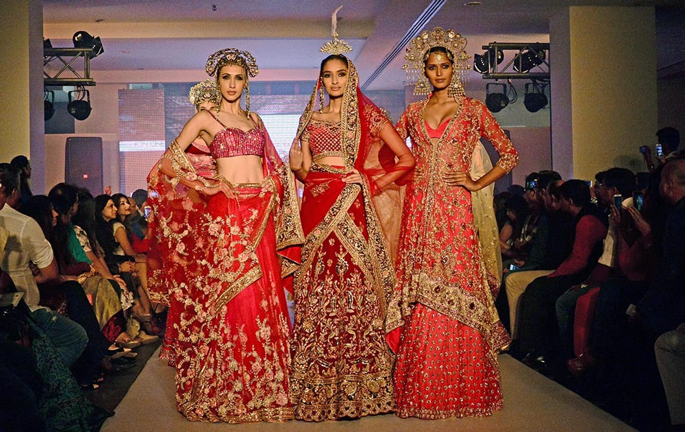 Models displays the wedding creation of designer Suneet Verma BMW bridal fashion week in Ahmedabad.