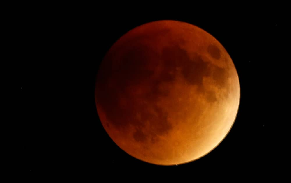 EARTH'S SHADOW OBSCURES THE VIEW OF A SO-CALLED SUPERMOON DURING A TOTAL LUNAR ECLIPSE NEAR LECOMPTON, KAN.