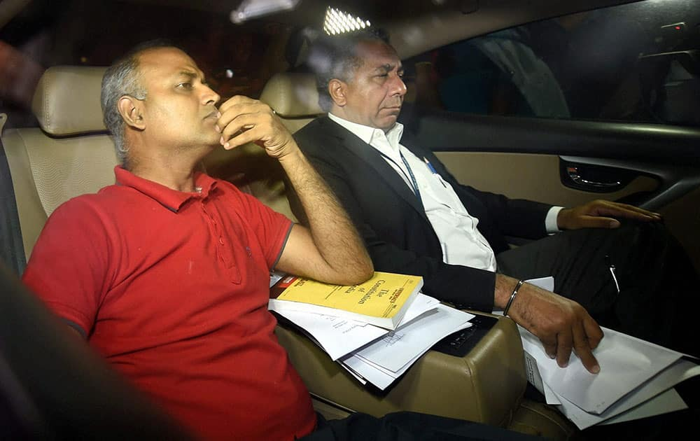 AAP MLA Somnath Bharti with his lawyer arrives to surrender at the Dwarka North Police Station in New Delhi.