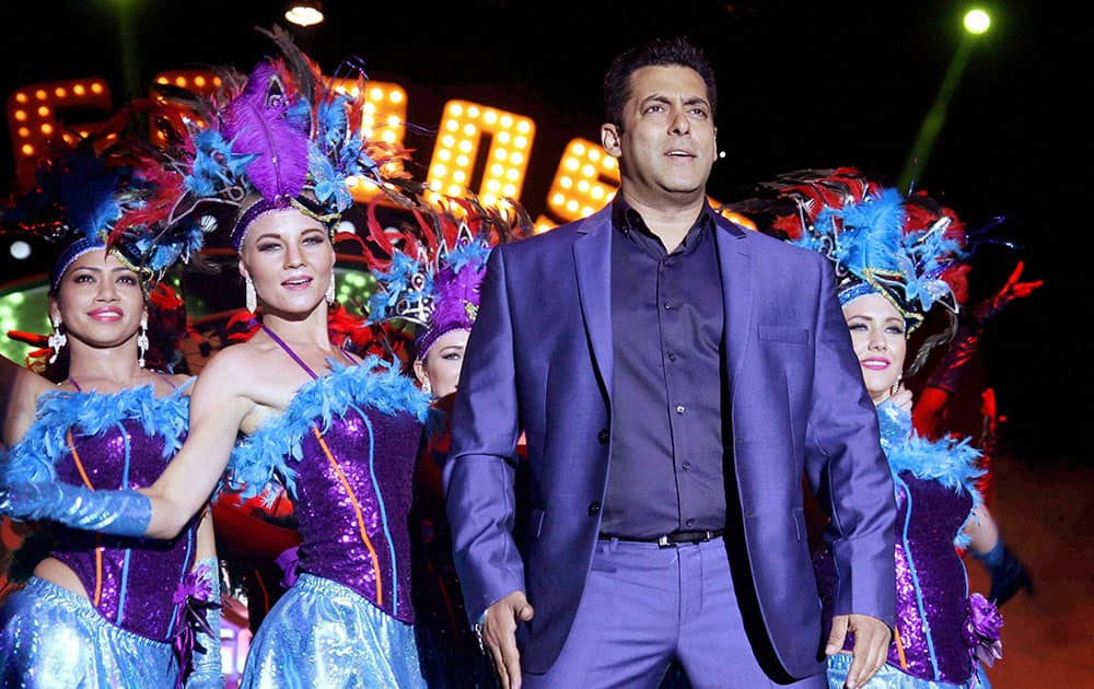 Bollywood actor Salman Khan performs during a press conference for the launch of reality television show Bigg Boss 9 'Double Trouble' in Mumbai.