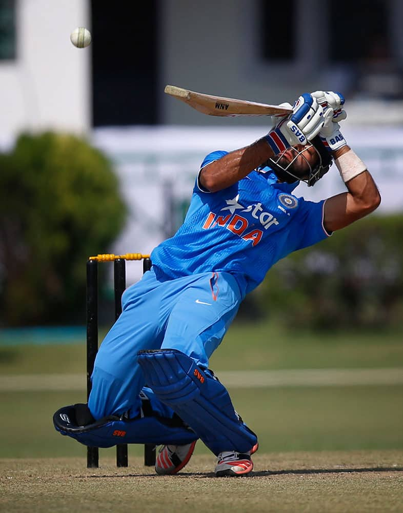 India A's Manan Vohra plays a ball against South Africa during a practice Twenty20 match in New Delhi.