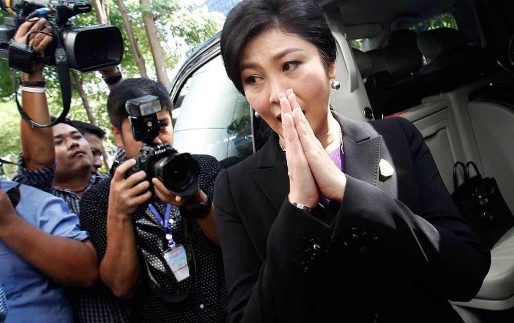 Thailand's former Prime Minister Yingluck Shinawatra leaves Bangkok's Criminal Court, Thailand.