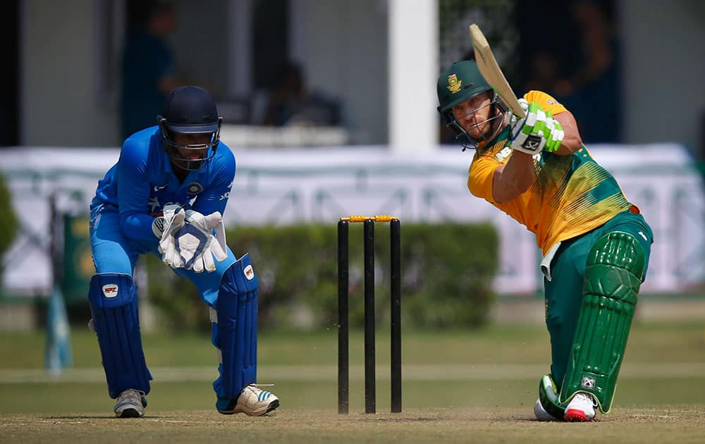 South African batsman Faf du Plessis hits a ball against India A during a practice Twenty20 match in New Delhi.